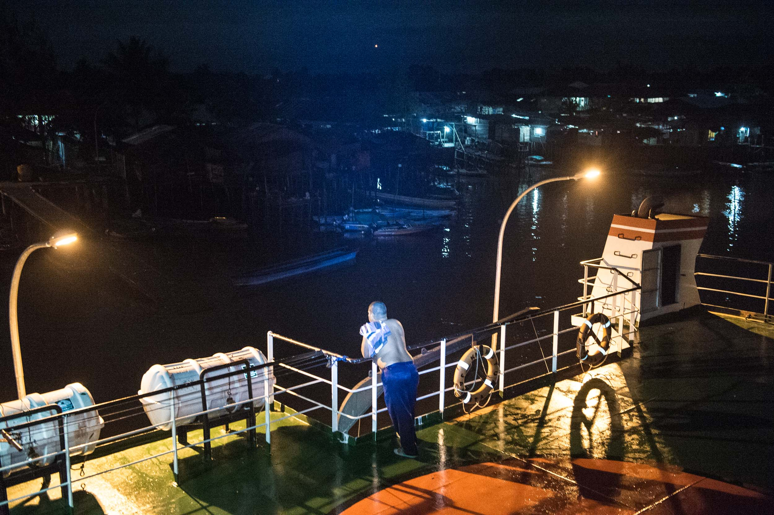 Agats at night from KMP Muyu supply ship • Agats, 2014